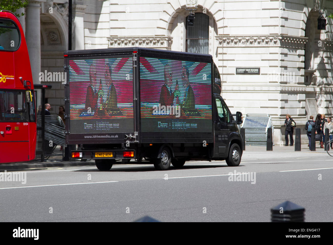 Westminster London,UK. 5th May 2015. A campaign poster on a media van shows pub landlord Al Murray who is standing - Stock Image