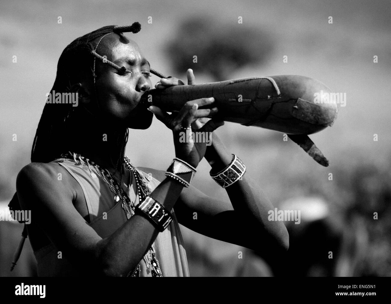 Maasai Warrior Drinking Cow Blood In A Calabash, Nakuru County, Nakuru, Kenya - Stock Image