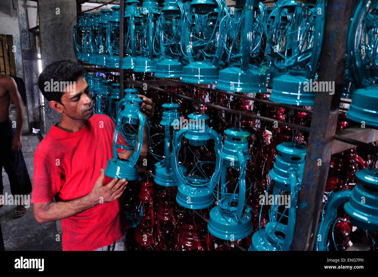 Superior A Labor Works In A Hurricane Lantern (oil Lamp) Factory At Kamrangyr Char  In Dhaka, Bangladesh. June 6, 2013