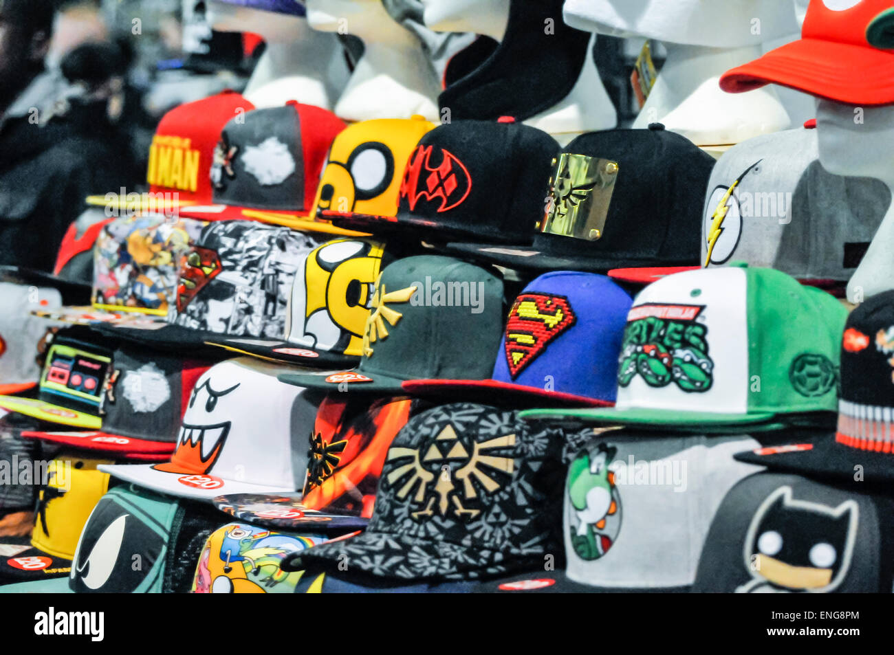 Baseball caps with comic book, manga and sci-fi logos - Stock Image