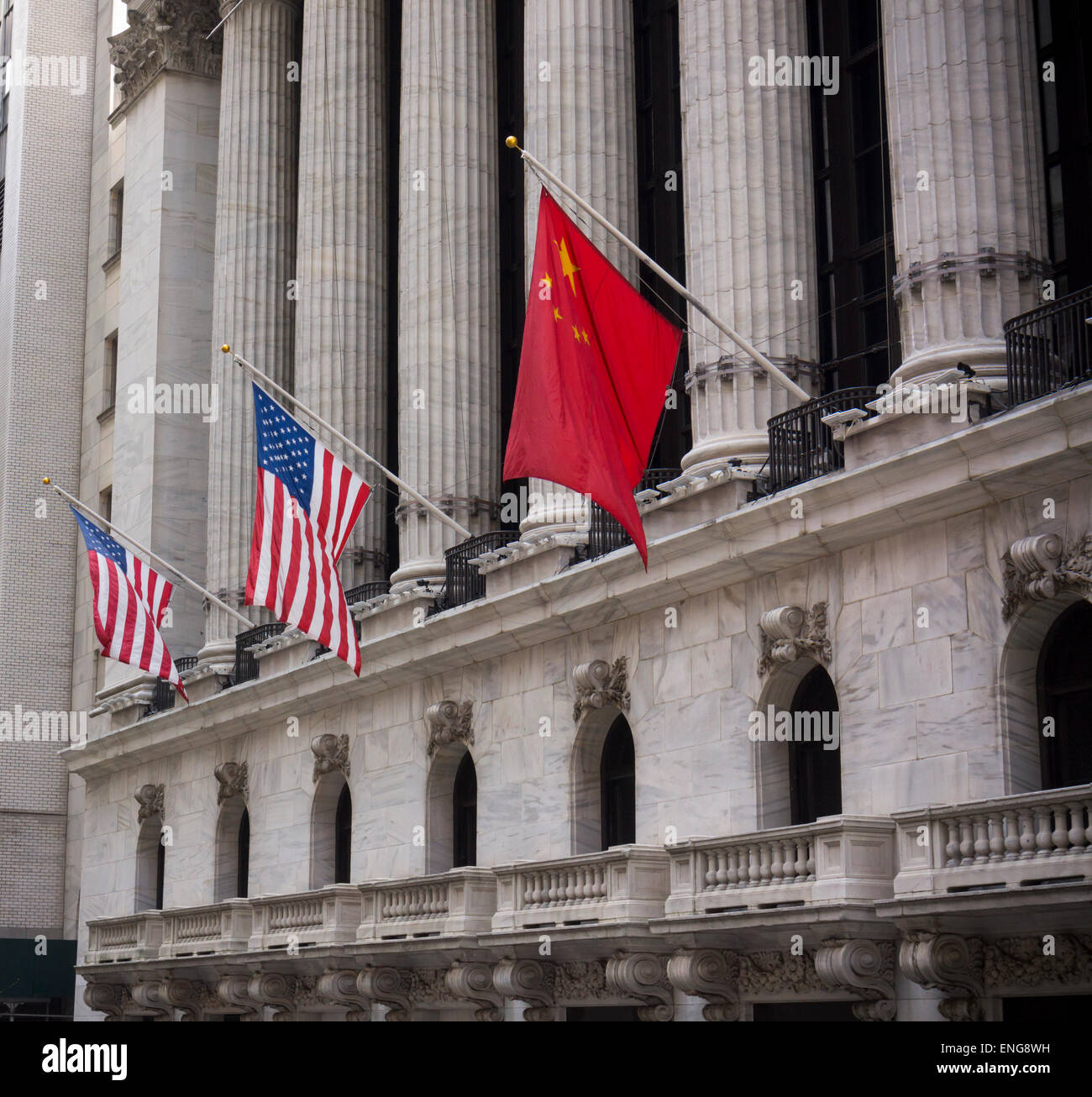 The New York Stock Exchange displays the People's Republic of China flag alongside the United States flag on - Stock Image