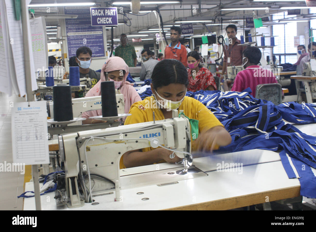 Workers inside an RMG (Readymade Garments) factory in Savar . Garments sector contributes the highest to the GDP - Stock Image