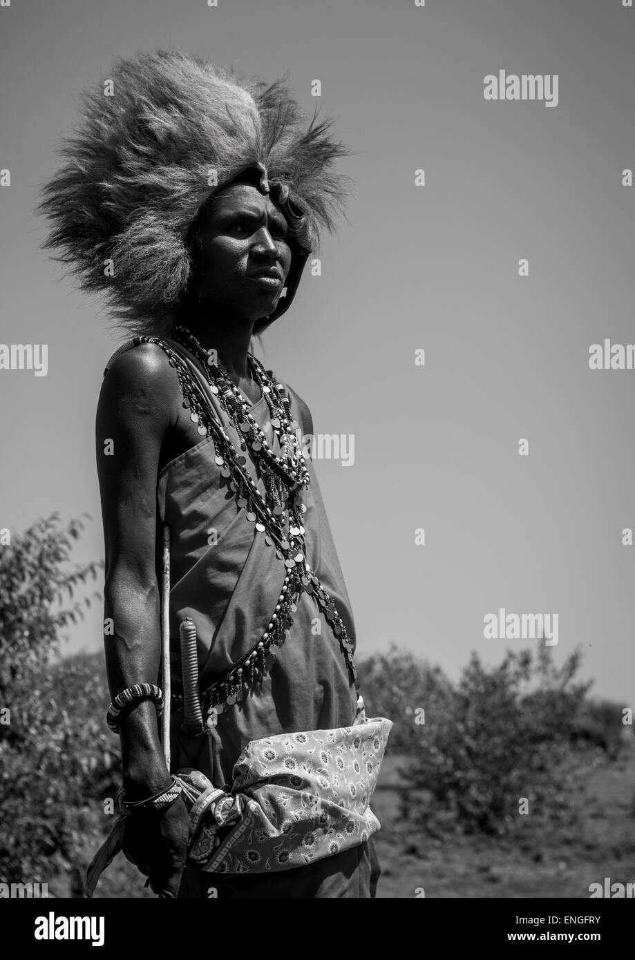 Maasai Warrior With A Lion Hat Fur On The Head, Nakuru County, Nakuru, Kenya - Stock Image