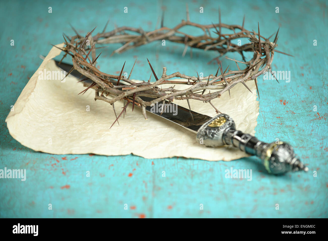Crown of thorns and Roman sword on vintage paper -Selective focus on crown - Stock Image