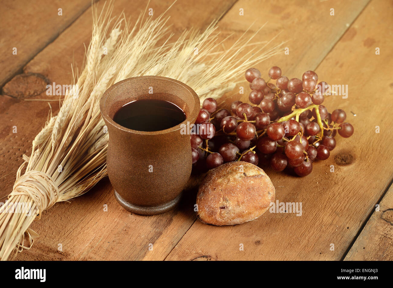 communion elements with wine and bread on wooden table stock photo
