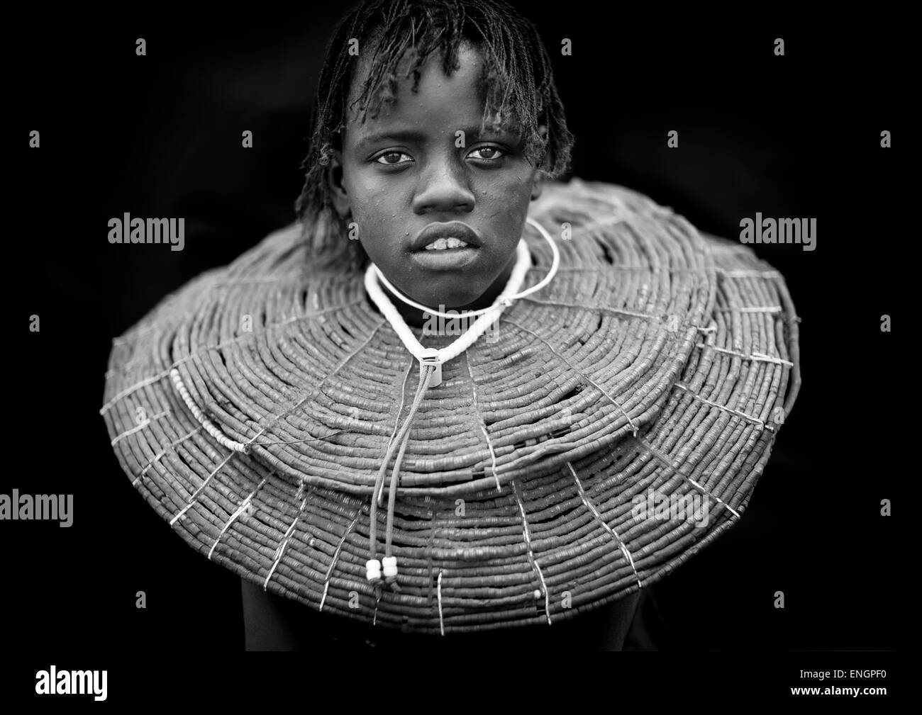 A Pokot Girl Wears Large Necklaces Made From The Stems Of Sedge Grass, Baringo County, Baringo, Kenya - Stock Image