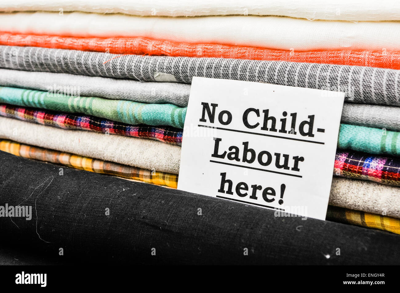 Sign at a cloth shop advising customers the no child labour is used in the production of their goods. - Stock Image