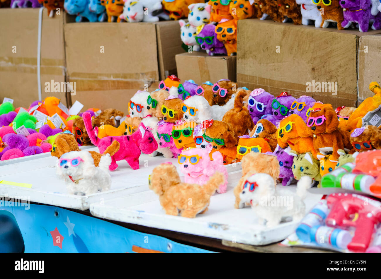 Colourful toy barking dogs on sale at a shop - Stock Image
