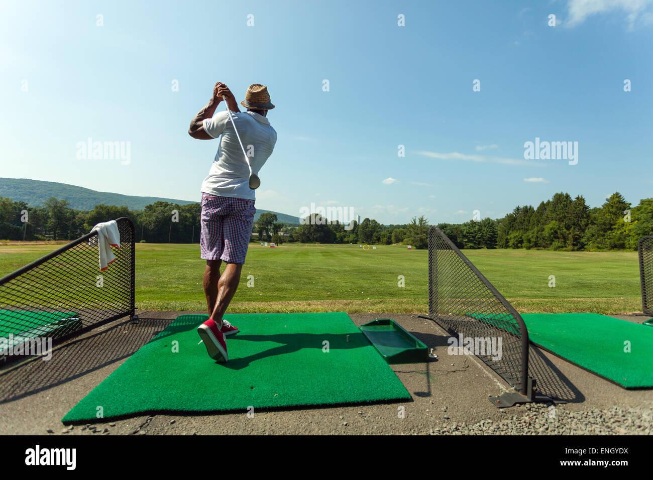 Driving Range Golf Swing - Stock Image