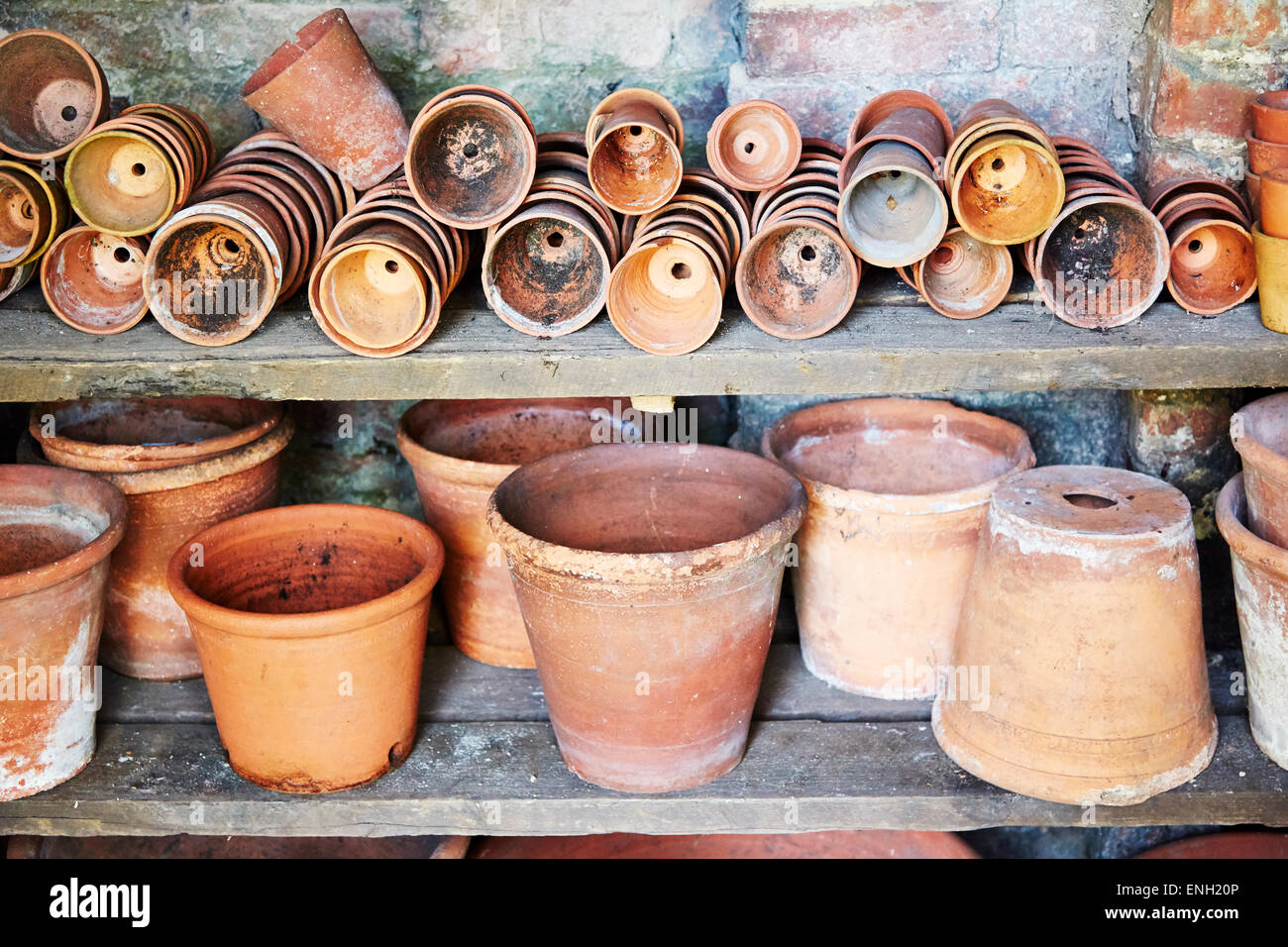 Selection of varying sizes of terracotta plant pots at Calke Abbey, Derbyshire, England, UK. - Stock Image