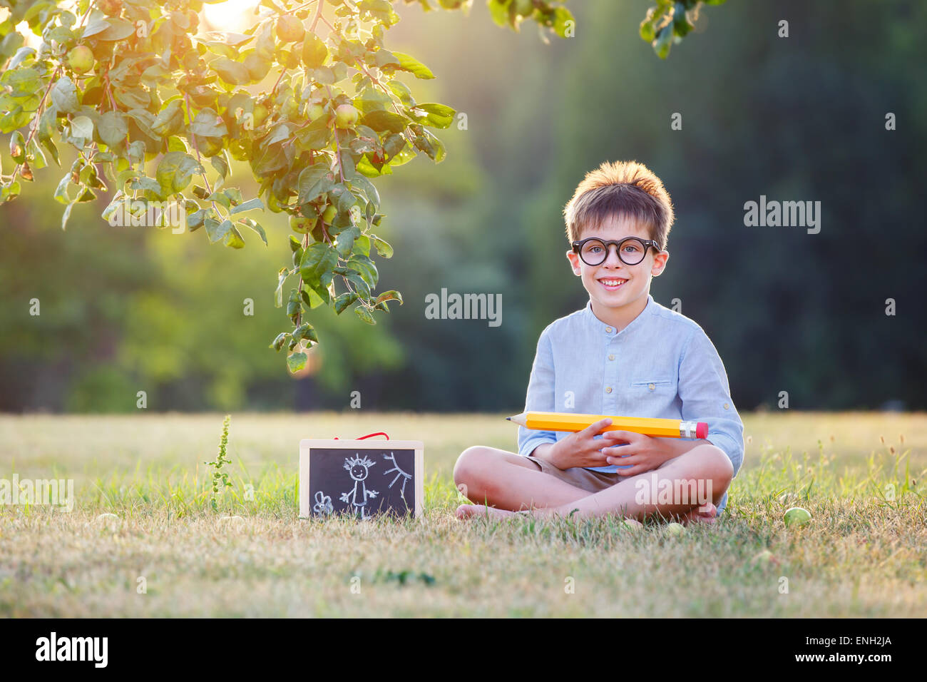 Cute little schoolboy feeling extremely excited about going back to school - Stock Image