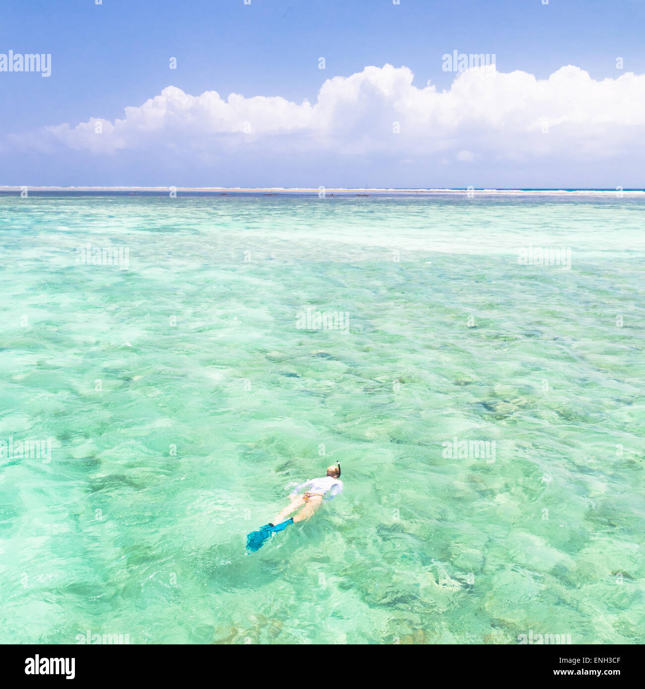 woman snorkeling in turquoise blue sea. - Stock Image