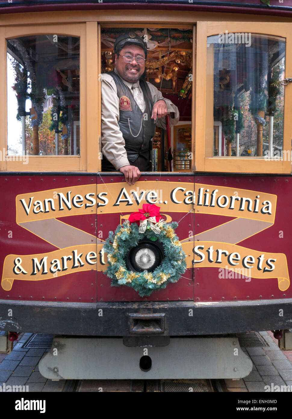 San Francisco Tram 'grip' operator poses at festive tram window Market Street terminus at Christmas San - Stock Image