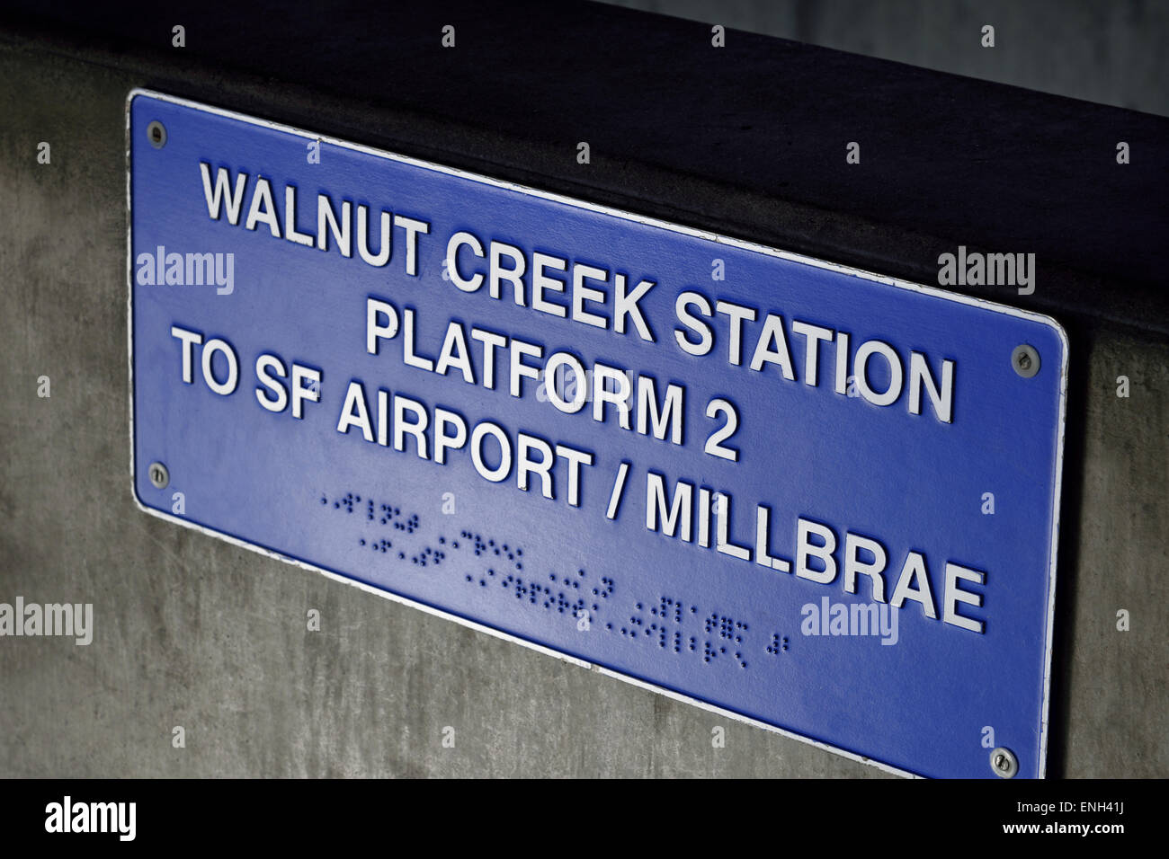 Metal plaque on Walnut Creek 'Bart' station with platform information duplicated in Braille for visually - Stock Image