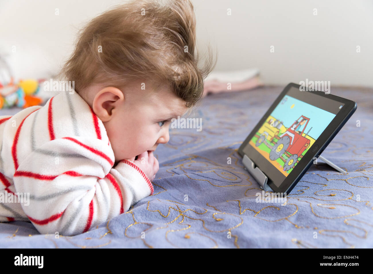 Six Month Old Baby Watching Nursery Rhrymes On Youtube On