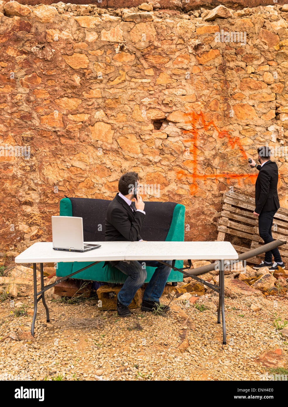 A bearish chart being drawn with graffiti on a ruin wall, a financial crisis concept - Stock Image