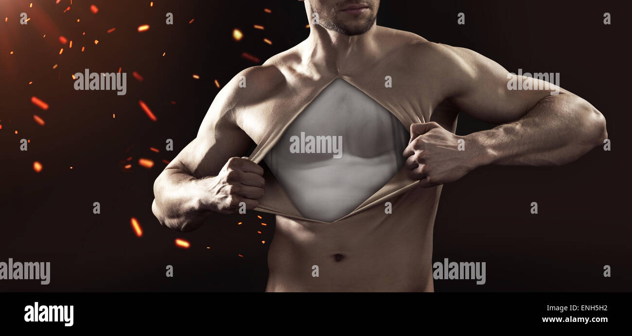 Guy tearing up his chest skin Stock Photo