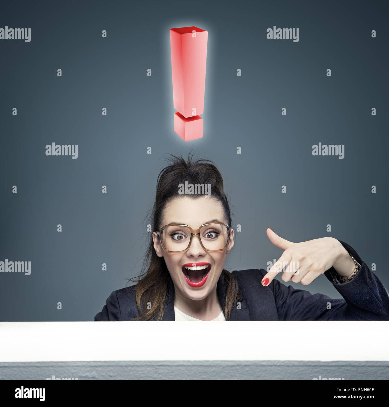 Businesswoman with a huge exclamation mark above - Stock Image