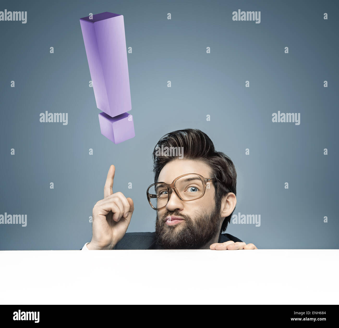 Portrait of a man with a huge exclamation mark - Stock Image