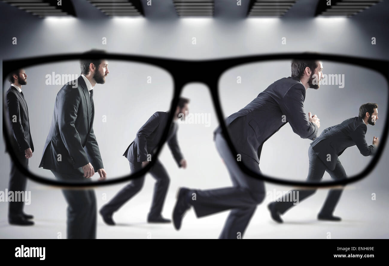 Focus on the numerous handsome businessmen - Stock Image