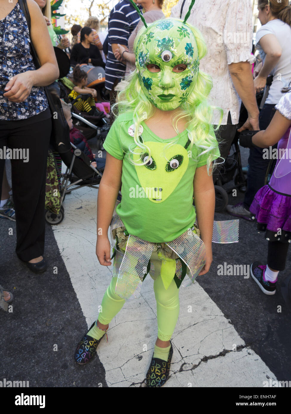 Girl dressed as Little Green Man or Martian at The Ragamuffin Parade in Bay Ridge in Brooklyn, NY. - Stock Image