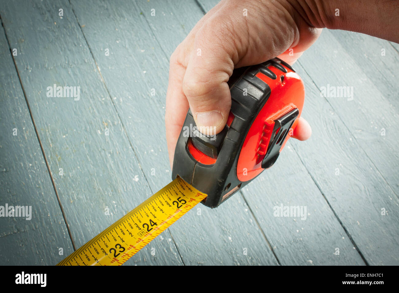 A tape measure extended to 25 inches. - Stock Image