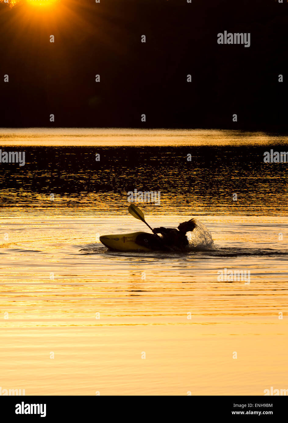 A kayaker silhouetted in the Sunset at 'Reservoir Park' Southern Pines, North Carolina, Moore County NC - Stock Image