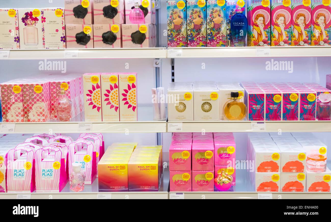 Perfume display in UK airport duty free shop. - Stock Image