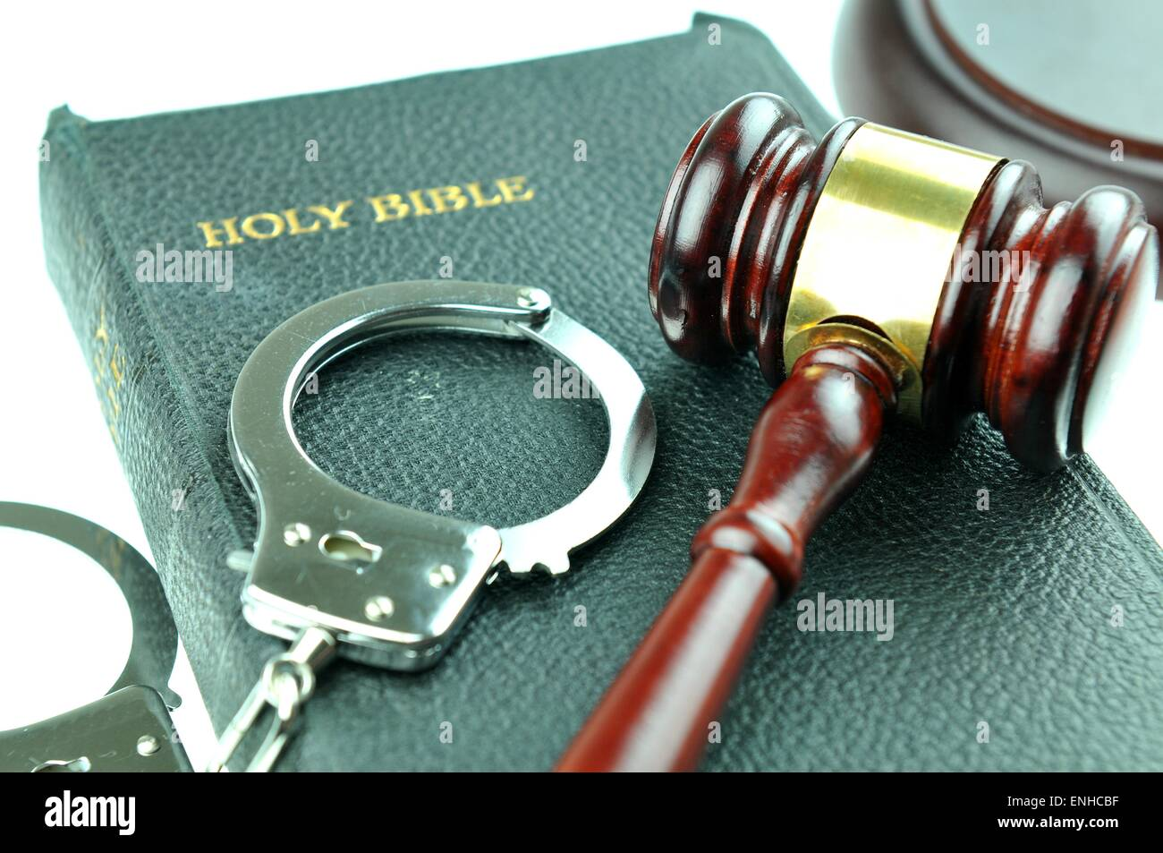 Image result for handcuffs and bible