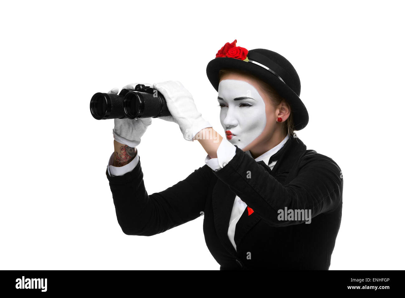 Portrait of the searching mime with binoculars - Stock Image