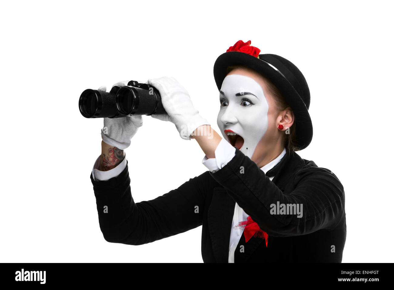 Portrait of the surprised and joyful mime with binoculars - Stock Image