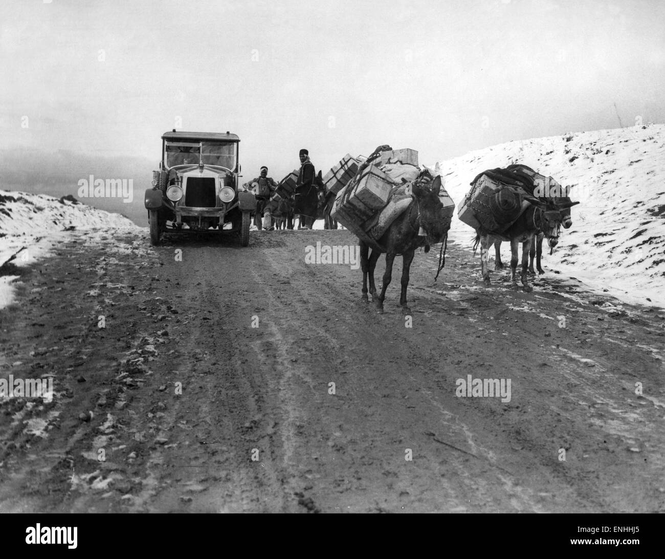 On the road to Tehran, on the tops of Aveh Pass (Name TBC), Circa 1926. Donkeys carry oil to Tehran, where petrol - Stock Image