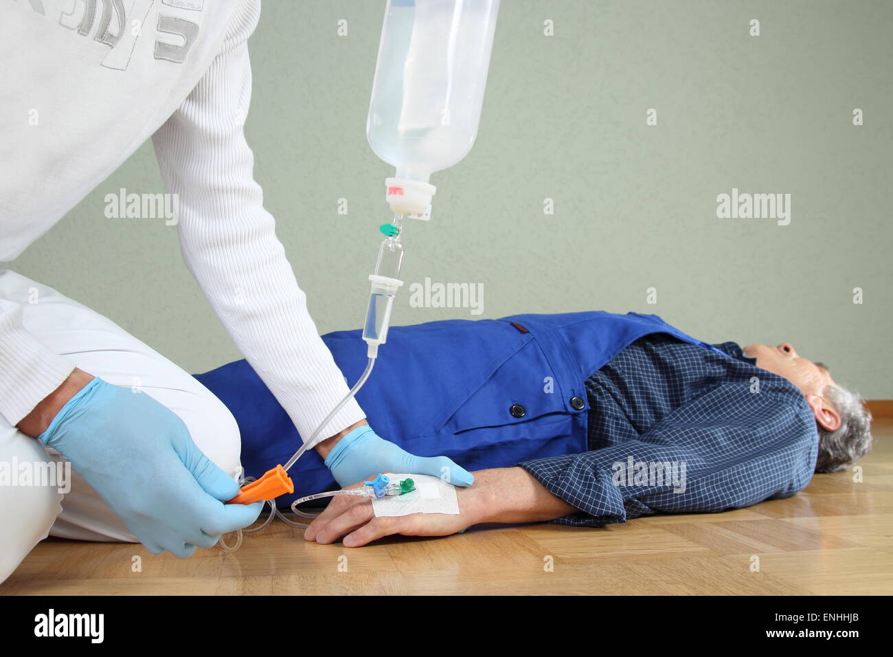 A Emergency service giving a infusion to a patient - Stock Image