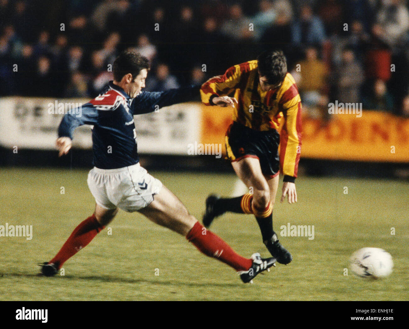 Falkirk footballer David Weir moving in to cut out the threat of Gerry Britton during the match against Partick - Stock Image