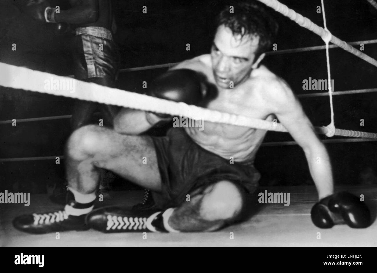 Charlie Hill boxer December 1957 Scots boxer against the ropes during fight - Stock Image