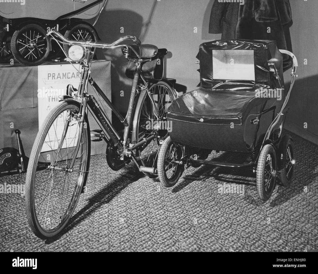 Transport: cycles: Baleys Pram to cycle. April 1953. - Stock Image