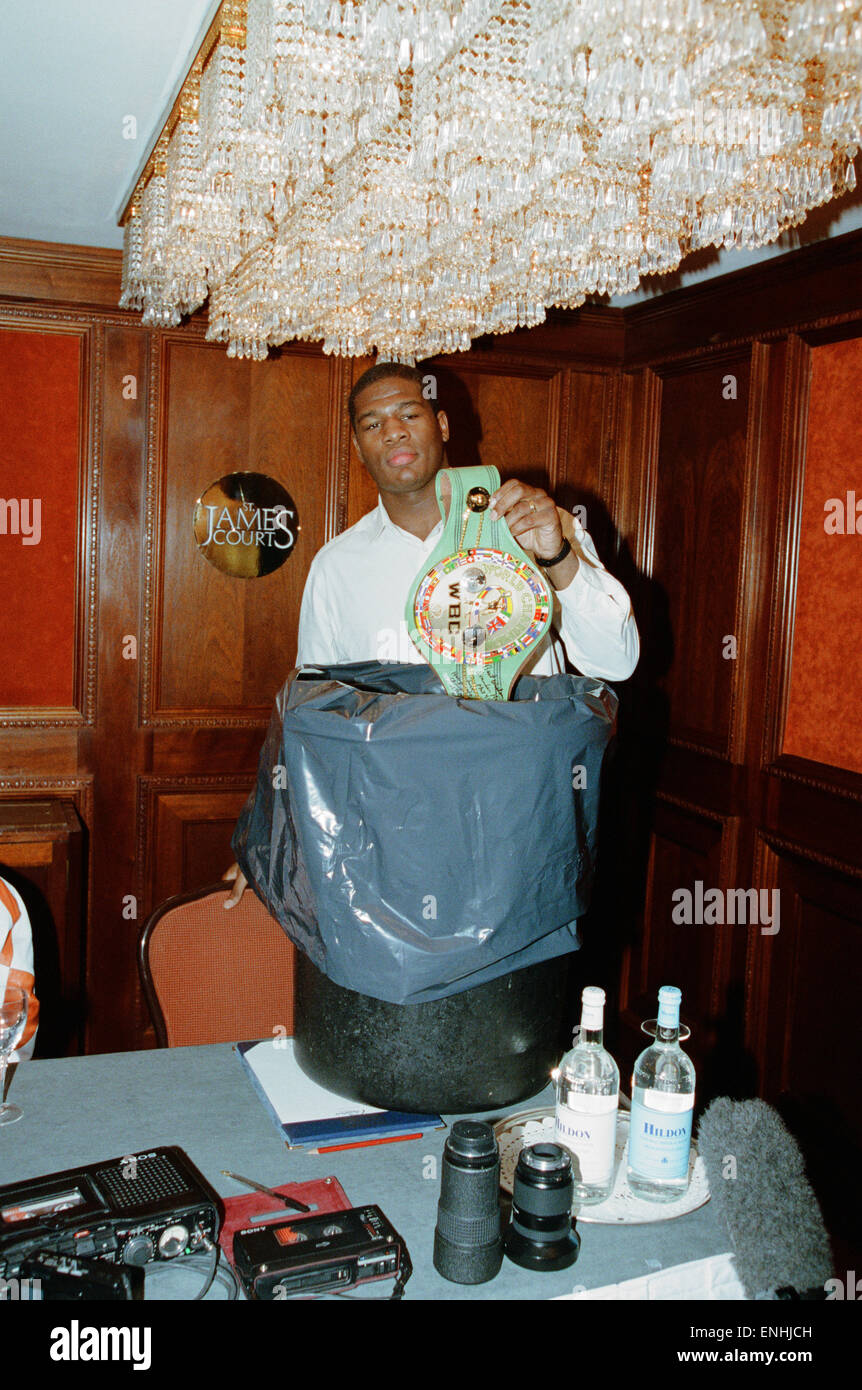 Riddick Bowe Boxer The Undisputed World Heavyweight Championship Puts His WBC Belt Into The Dustbin At A Press Conference - Stock Image