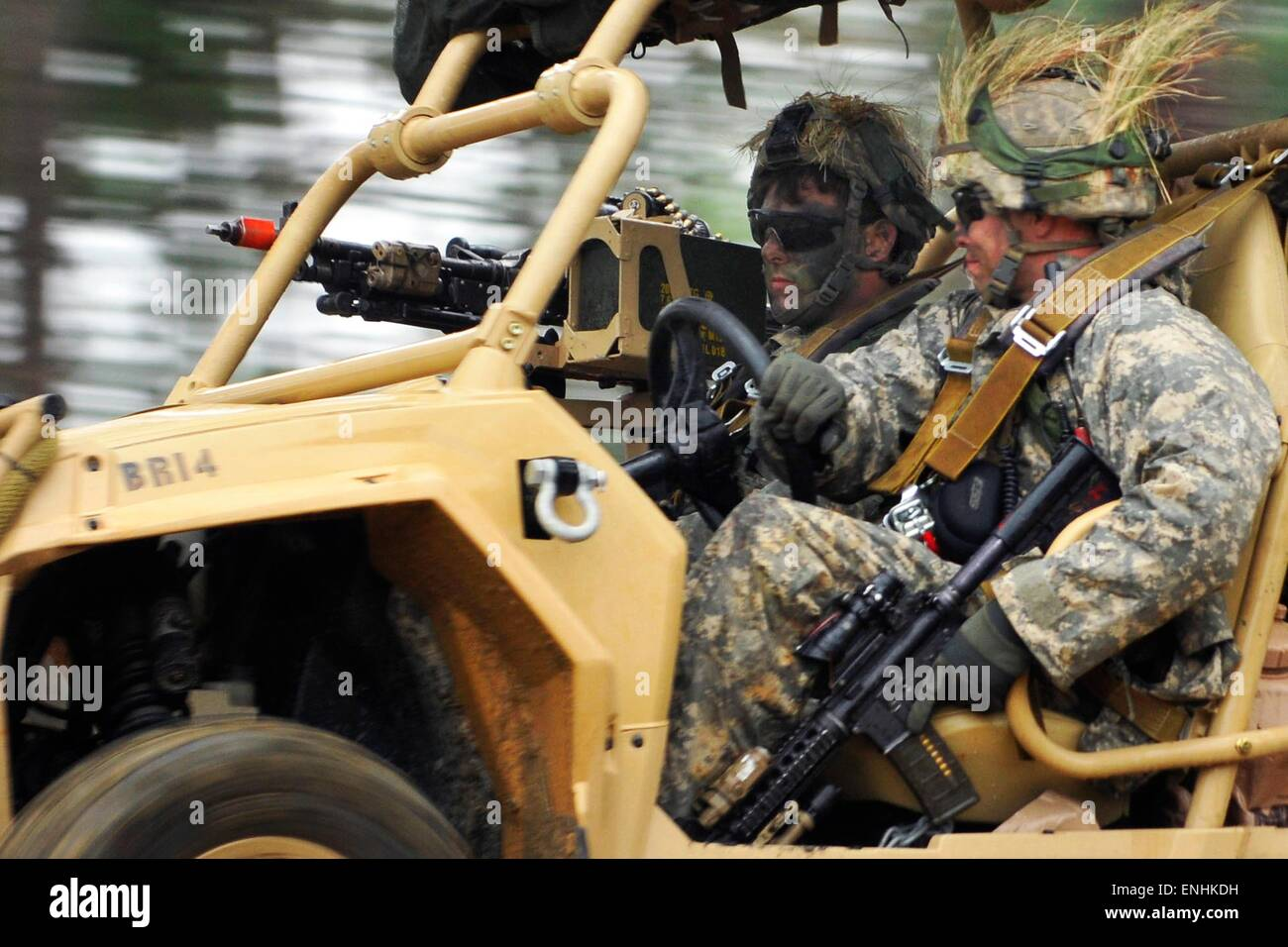 U.S. Airborne paratroopers drive Light Tactical All Terrain Vehicles during Combined Joint Operational Access Exercise - Stock Image