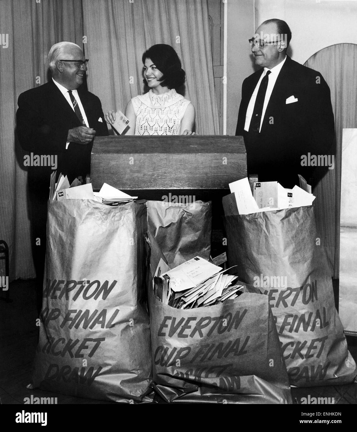 World Cup Queen 1966. Sheila Forrest makes a draw for the balance of Everton's share of tickets for the FA Cup - Stock Image