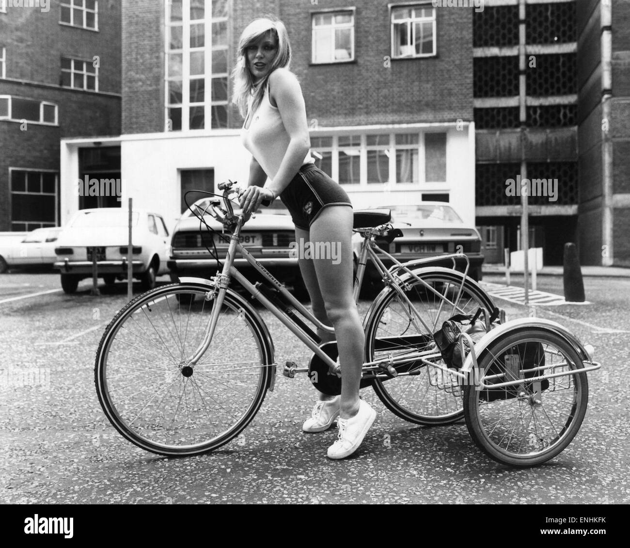 Transport Cycles: Model Ann West (left) finds that three wheels are easier than two when she carries her bag of Stock Photo