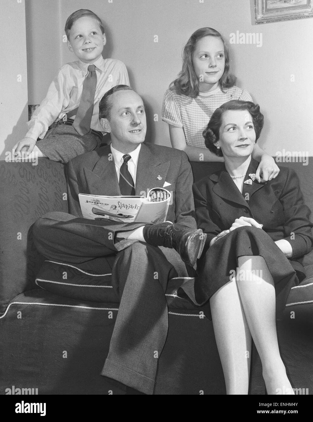 Tv presenter Hughie Green seen here at home with his family. Circa 1955 Stock Photo