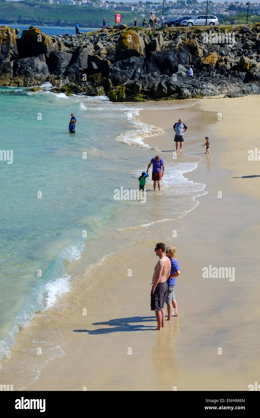 Holidaymakers on the beach at St Ives in Cornwall - Stock Image