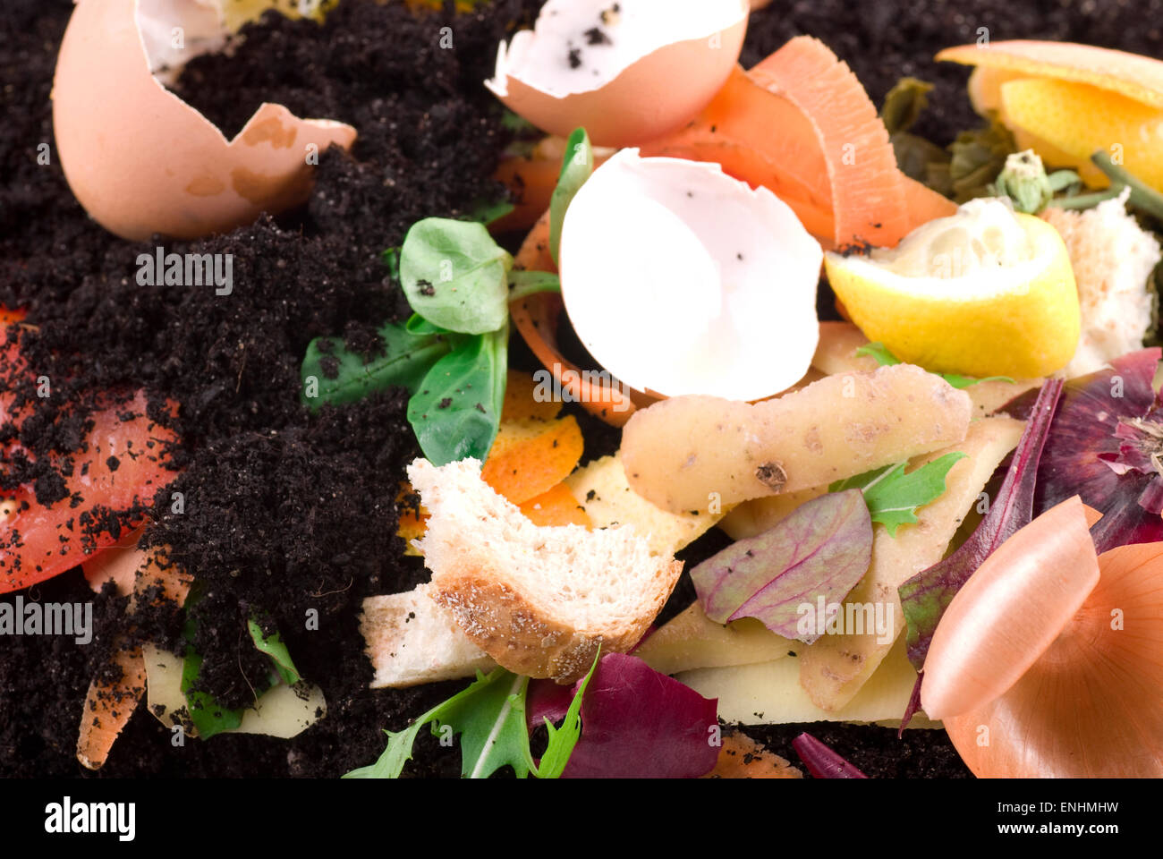 Compost material on soil. Cross section.  Close up. - Stock Image