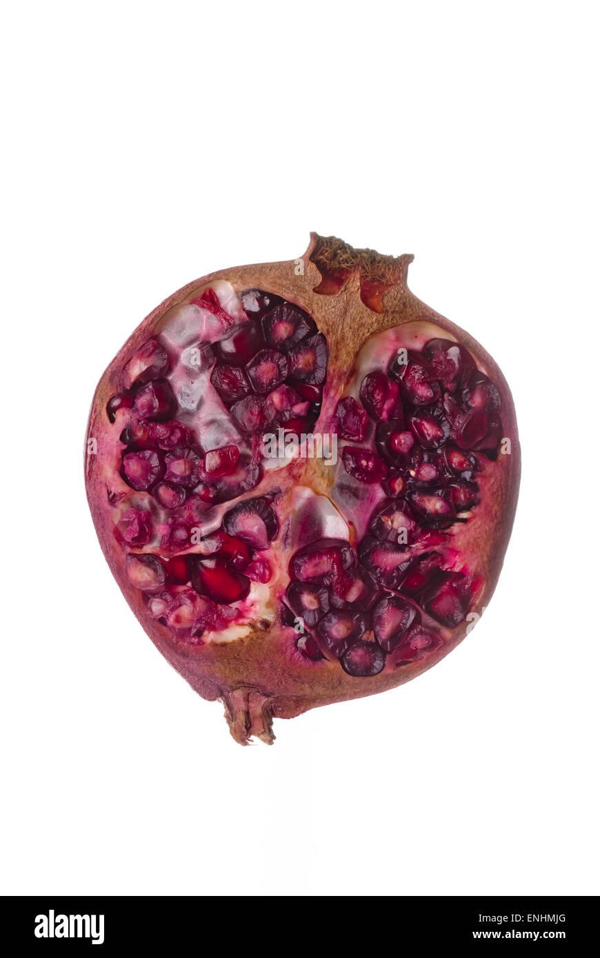 Half pomegranate on white background. - Stock Image