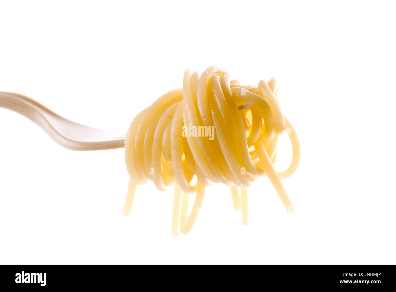 Spaghetti with olive oil on a plastic fork. - Stock Image