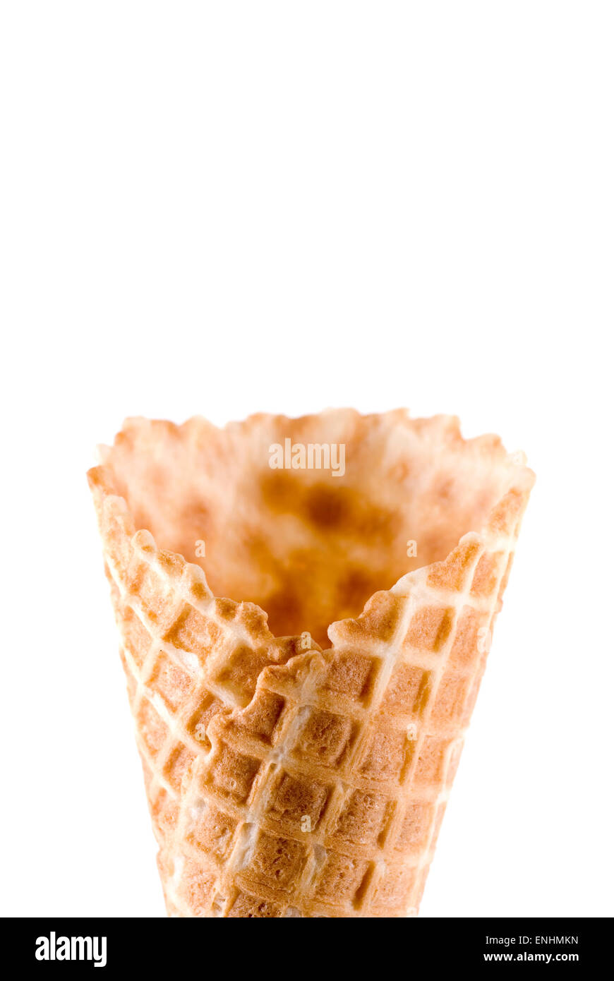 Empty ice cream waffle cone on white background. - Stock Image