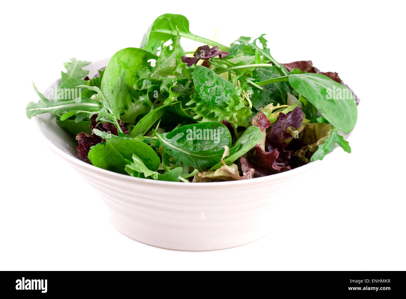 Spinach, arugula, lollo rosso and green salad in a ceramic bowl. - Stock Image
