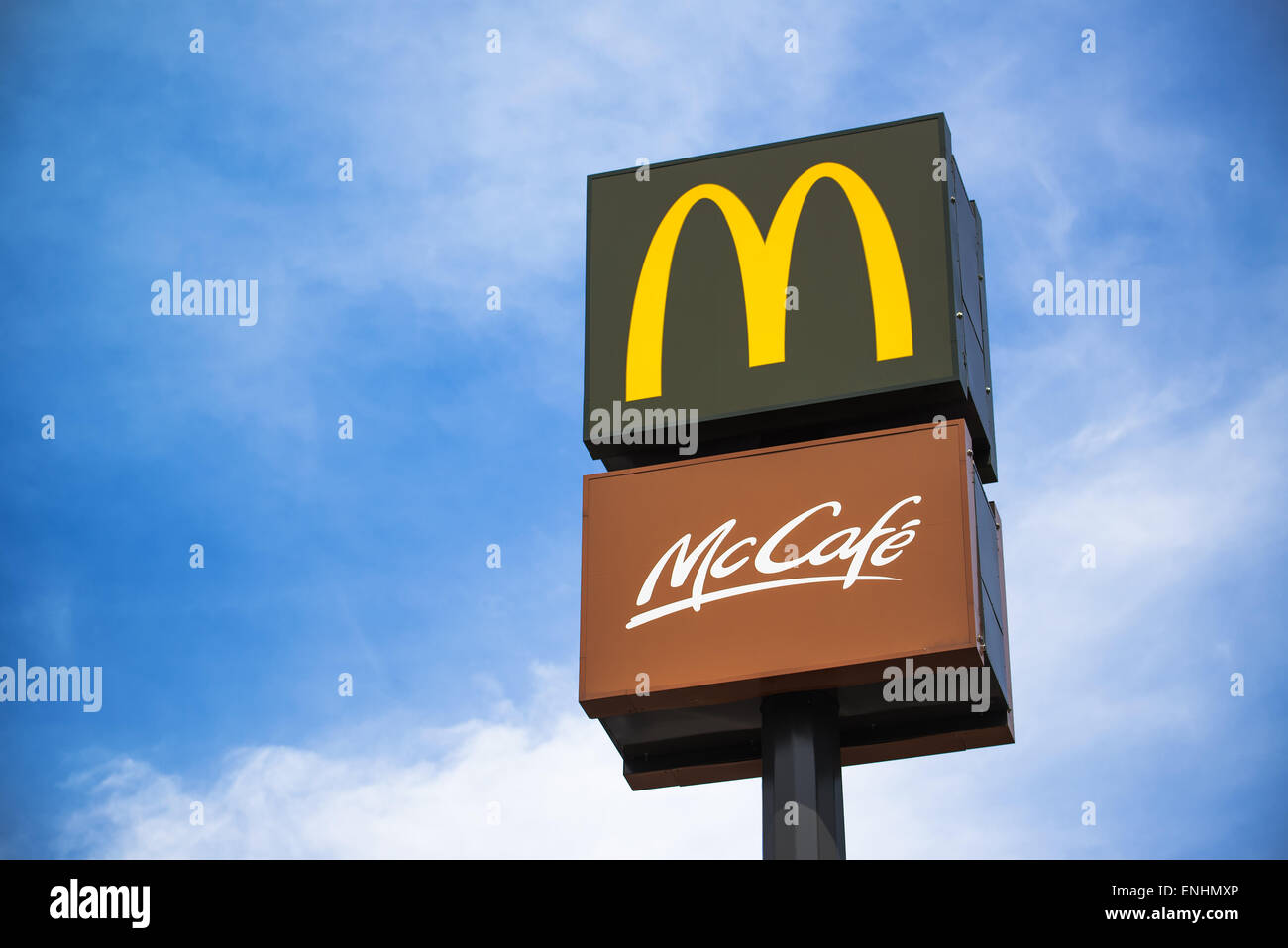 NOVI SAD, SERBIA - MAY 5, 2015: McDonalds and McCafe Signs on Post to mark fast food restaurant. Illustartive editorial - Stock Image