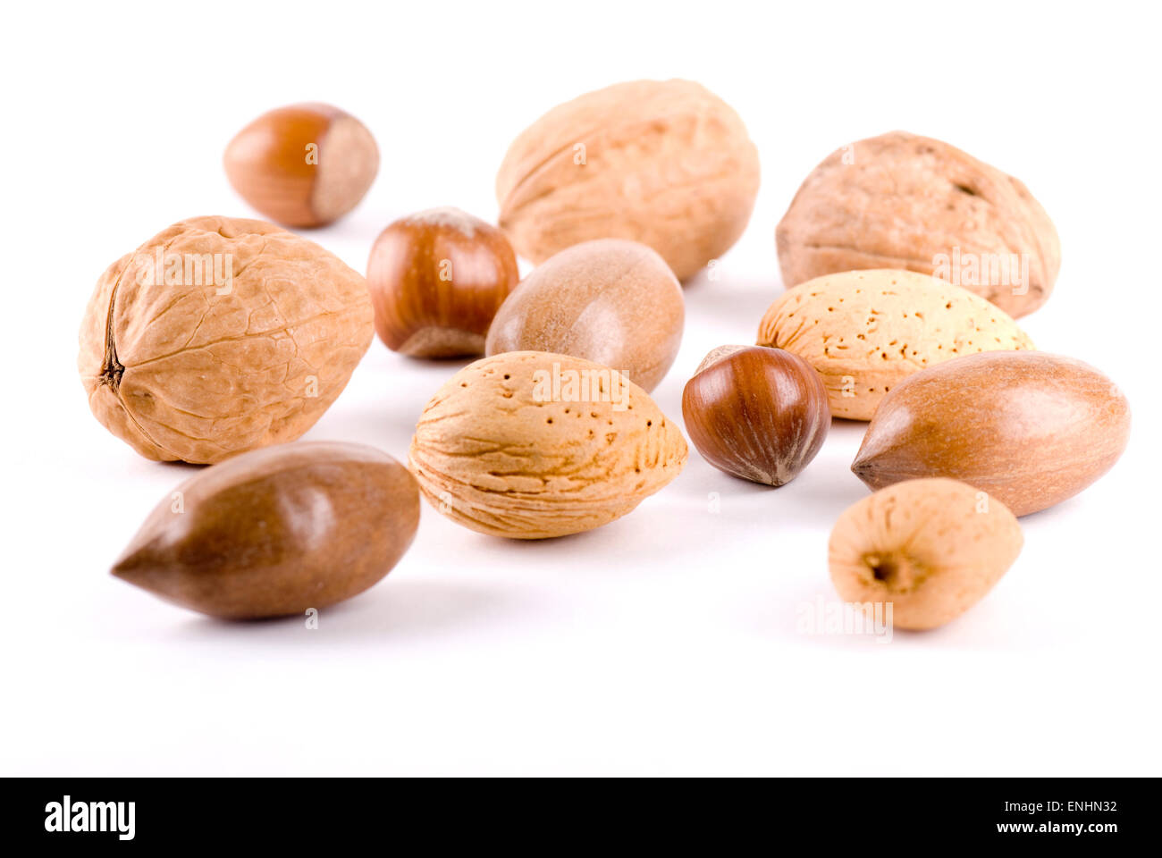Mixed nuts close up on white background. - Stock Image