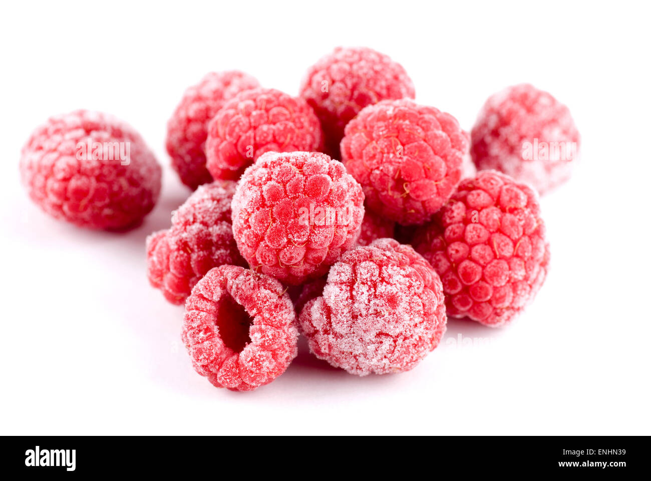 Heap of frozen raspberries close up background. - Stock Image